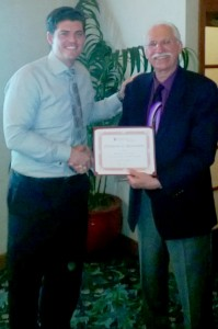 Bob presents speaker with a certificate: Ryan Greer Attorney At Law Magazine